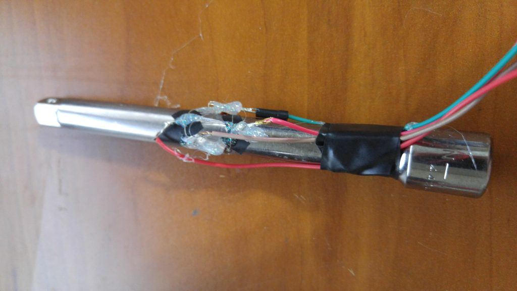 Torque Sensor with hot glue, electrical tape, and wires